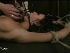 a gorgeous brunette with beautiful tits and ass gagged and tortured