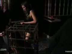 a caged whore gets fucked by strangers in a bar