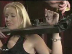 a very interesting scene with men and women in a bondage orgy