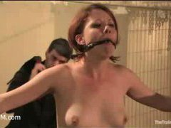 a redhead slave trainee pushed through her paces