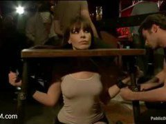 An anal whore disgracefully fucked in a crowded bar