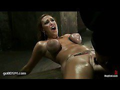 An oiled-up pornstar gets her pussy learned to cum brutally