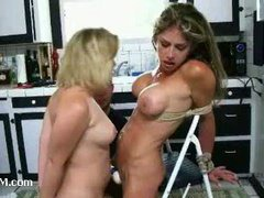 A silly busty blond slut dominated by a kinky couple