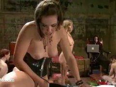 Three hot mistresses make superb domination action over three male slaves