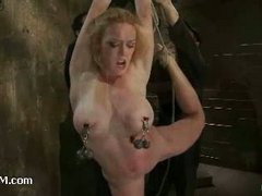 A busty limber slut bound in a strict back arch