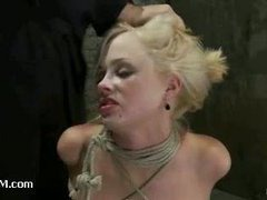 A big-breasted blonde slut mouth fucked in hard bondage