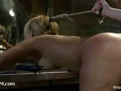 A huge titted MILF gives up her holes to a lusty mistress