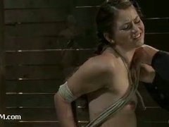 A cute nubile girl endures the tension of the ropes