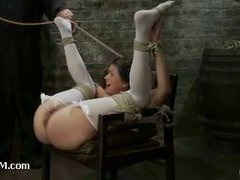 A sweet cutie gets her legs spread wide by ropes and squirts