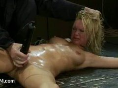 An oversexed slut mutters and wriggles in orgasmic pleasure