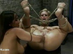 A blonde slut strap-on fucked in diabolical bondage