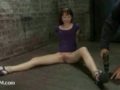 A juicy teen babe arching from crotch rope tension