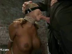A booming MILF choking on cock while tied