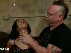 A curly brunette squirms from extremely sadistic treatment