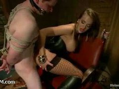 A redheaded slave boy worships boots and has his cock tramped