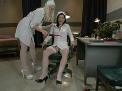 A hot brunette takes electrical play from the Head Nurse