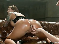 A big-titted hottie anally fisted and dominated in intense threesome