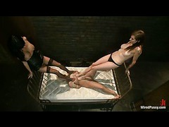 Two brunette mistresses having kinky fun with a busty blond