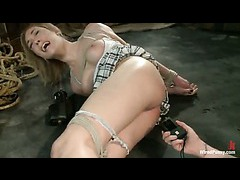 A classy blonde teen struggling in suspension while shocked