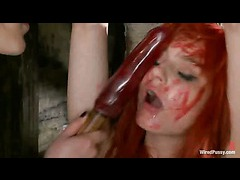 A wired redhead rewarded for her suffering with a wet pussy