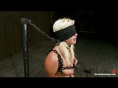 A juicy blonde chained down to the sybian and zapped ruthlessly