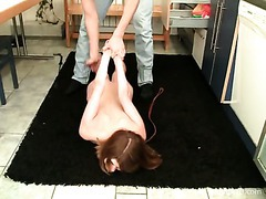A lusty teen cutie cuffed to a table and fucked rough