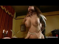 A busty brunette sodomized by a perverted couple