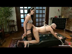 A guy chained to the bed and dominated by his maid