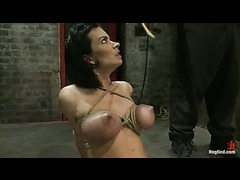 A busty pornstar cums unstoppably with her legs spread and tied