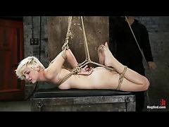 A blonde bondage slut is cumming in a hazardous hogtie