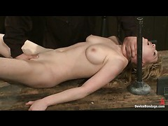 A slim blonde stretched out on the table and tortured with caning