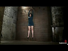 A hot MILF hooked with a crotch rope and flogged