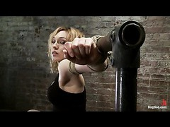 A delightsome blonde cumming fiercely in partial suspension