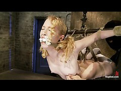 A curly redhead cums fiercely in a modified hogtied suspension