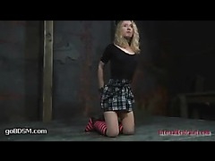 A cute blonde gets tormented in upside down split suspension