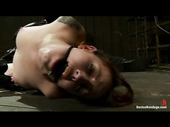 A slutty redhead gets her pussy colored red from flogging and vibrating
