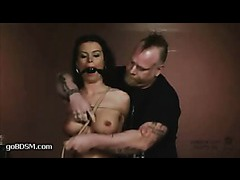 A fervent brunette enjoys being abused in inescapable predicament