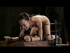 A brunette bondage slut roaring from tortures in a tight suspension
