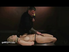 A luxurious blonde tied up and violated by the anal fucking machine
