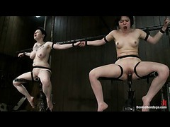 Two sluts taking the meanest machine fucking in strict restraints