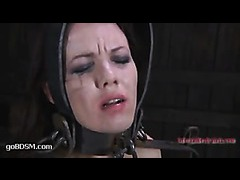 A desperate slut locked into an insidious bondage device