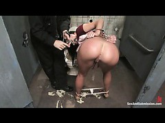 A sultry brunette gets tied up and fucked in the dirtiest public bathroom