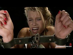 A little blond slut in steel restraints banged hard by a big cock