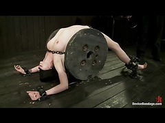 A petite brunette takes vicious beating in unforgiving restraints