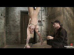 A curvaceous blonde cumming helplessly in inverted suspension