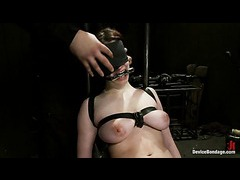A big titted redhead gets her swollen pussy vibrated in metal bondage
