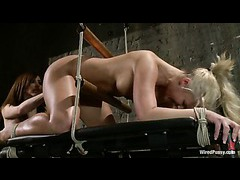An oiled up blonde gets her plump ass fisted and strap-on fucked