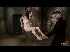 A fresh slut suffering from crotch rope and caning in tight suspension