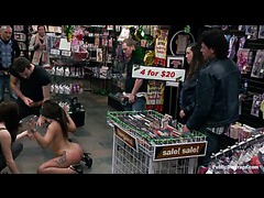 A shackled latina gets her shapely butt fucked by strangers in a porn store