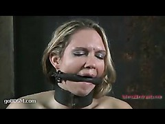 A tattooed pain slut gets her ripe tits smashed and abused in bondage